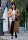 Jenna Dewan wears a beige trench coat as she heads to a Salon in Studio City, California