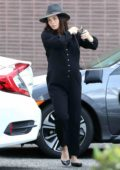 Jenna Dewan wears a black jumpsuit and a hat while out running errands in Beverly Hills, California