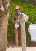 Jennifer Aniston dons a black bikini while on the beach in Tulum, Mexico