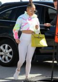 Jennifer Lopez wears a cropped tie-dye hoodie and leggings as she arrives at the gym in Miami, Florida