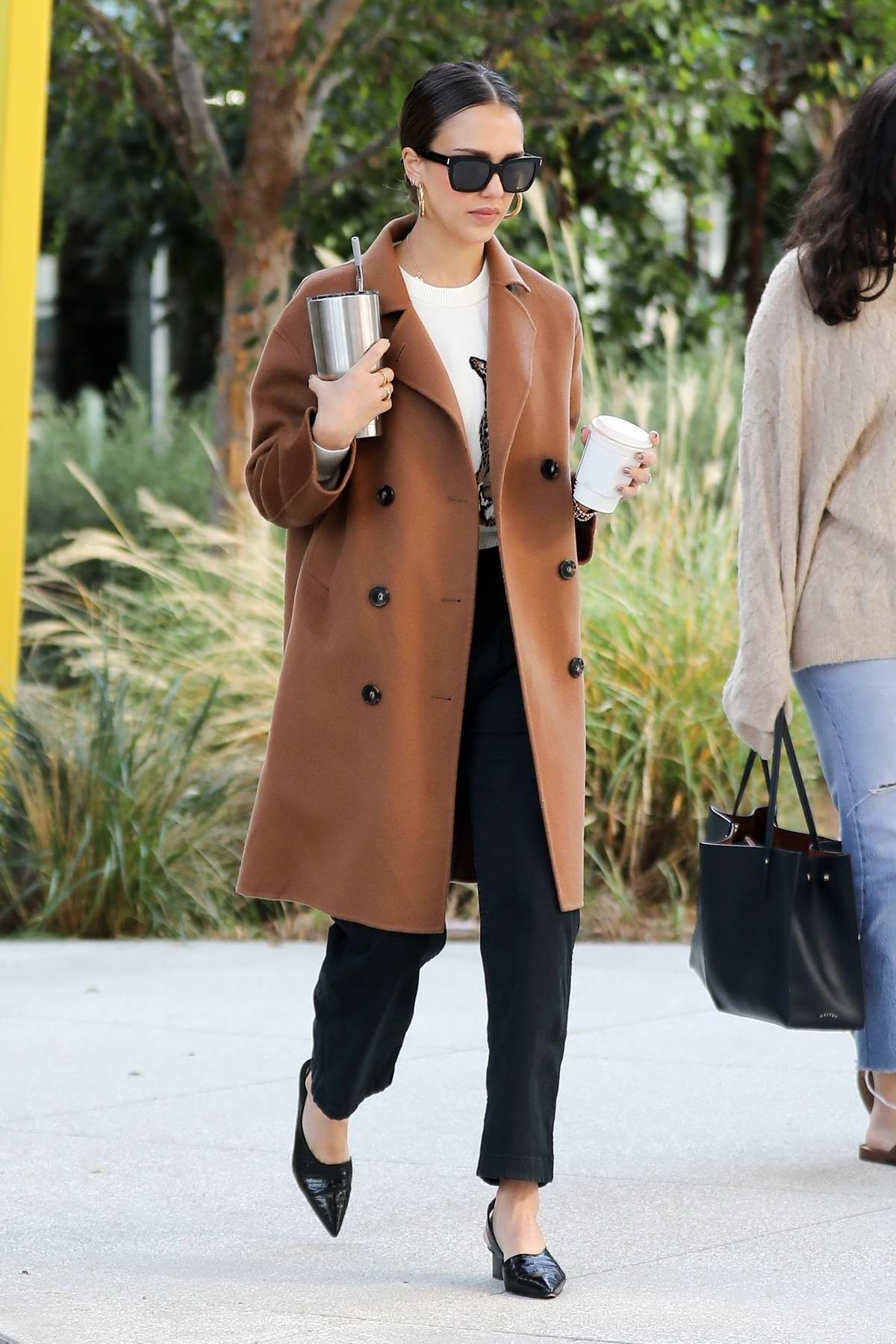 Jessica Alba looks chic as she arrives at the Honest Company headquarters in Santa Monica, California