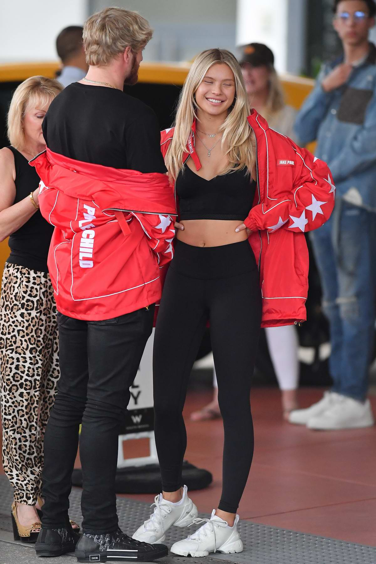 Josie Canseco wears a red jacket with black top and leggings while out with boyfriend Logan Paul in Miami, Florida