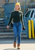 Julianne Hough wears a green sweater and tight jeans as she steps out to run errands in Studio City, California