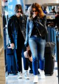 Kaia Gerber and Cindy Crawford sport matching leather jacket as they arrive at LaGuardia airport in New York