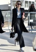 Kaia Gerber looks chic in a black suit as she arrives at the Chanel fashion show in Paris, France