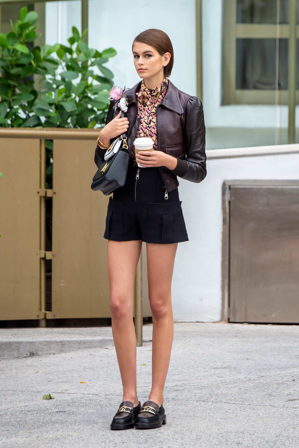 Kaia Gerber looks fashionable in multiple outfits during a Louis Vuitton photoshoot in Miami Beach, California