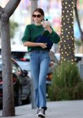 Kaia Gerber looks stylish in a green top and jeans as she stopped by Alfred's coffee in Beverly Hills, California