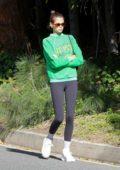 Kaia Gerber rocks a green sweatshirt and black leggings while out for a solo walk in Malibu, California