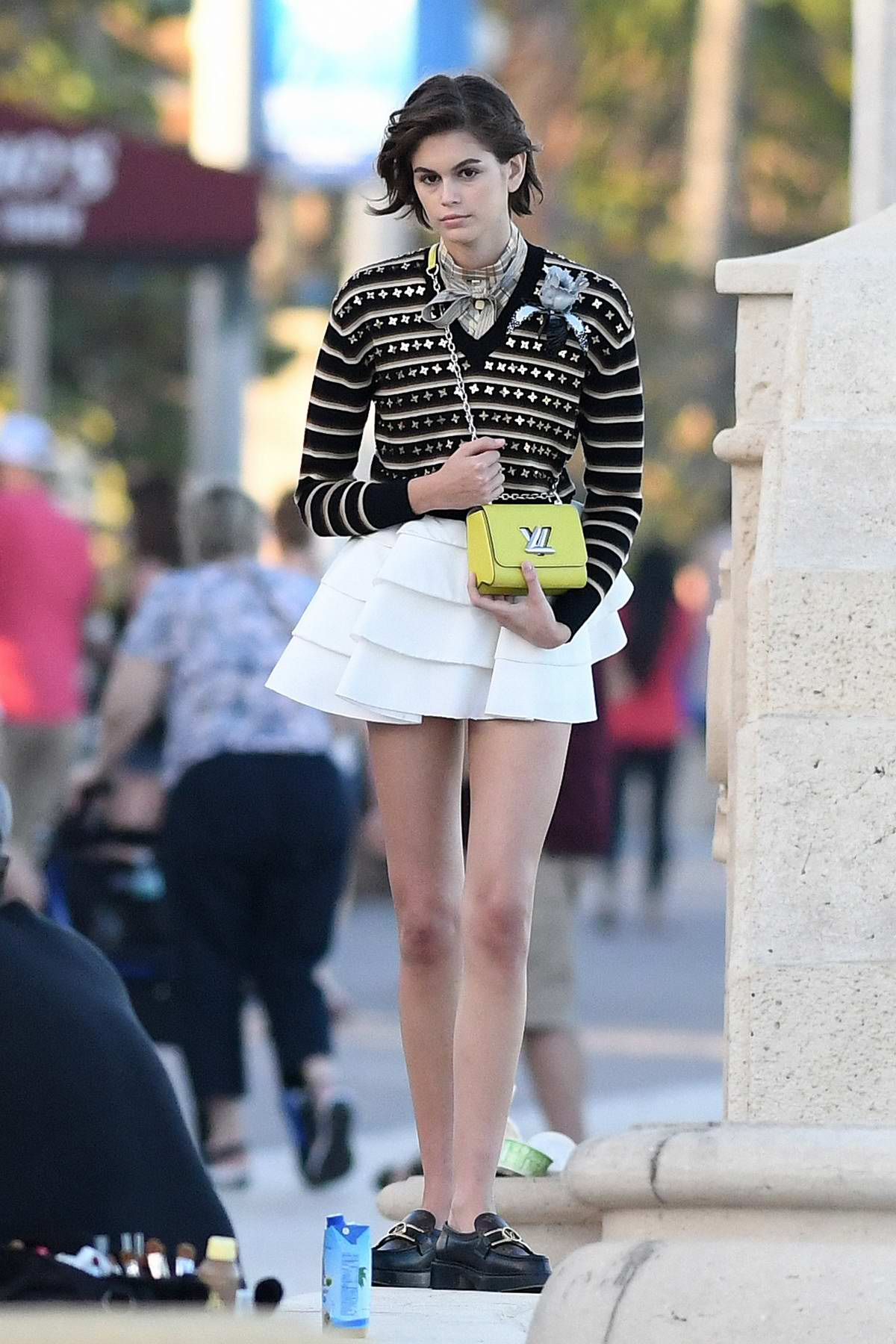 Kaia Gerber shows off her mile-long legs during day 3 of Louis Vuitton photoshoot in Miami, Florida