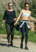 Kaia Gerber shows off her slender figure in crop top and leggings while out on a hike with a friend in Malibu, California