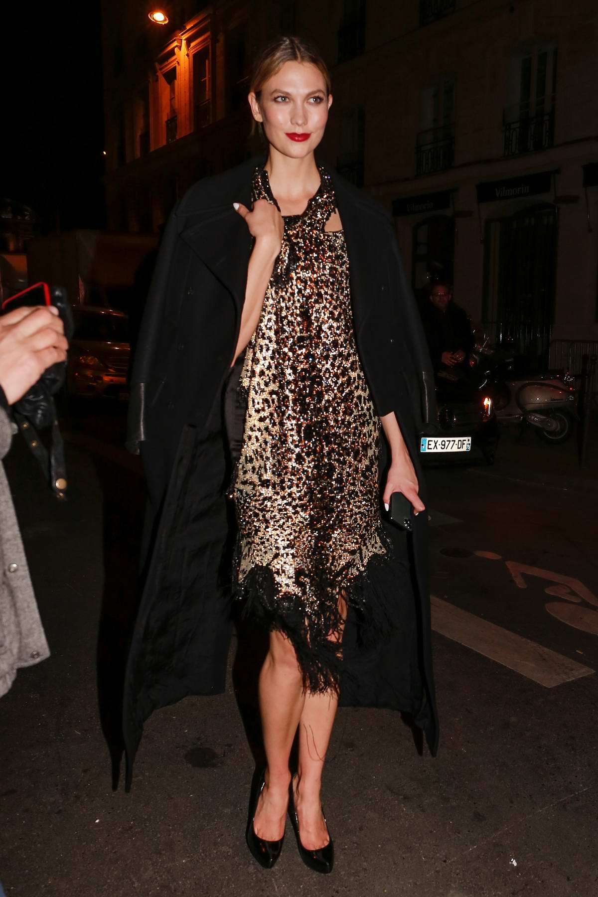 Karlie Kloss looks great in an animal print dress as she leaves the Jean Paul Gaultier show in Paris, France