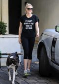 Kate Upton is all smiles as she leaves Bruno's gym with her dog in Beverly Hills, California