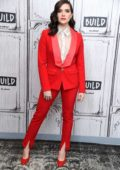 Katie Stevens dons a bright red suit as she visits Build Series in New York City