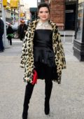 Katie Stevens poses for photos outside Build Studios in New York City