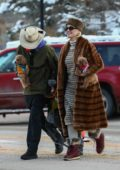 Katy Perry and Orlando Bloom carry their dogs as they head for some snowboarding in Aspen, Colorado