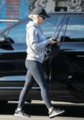 Katy Perry wears a baseball hat with a hoodie and leggings as she goes shopping in West Hollywood, California