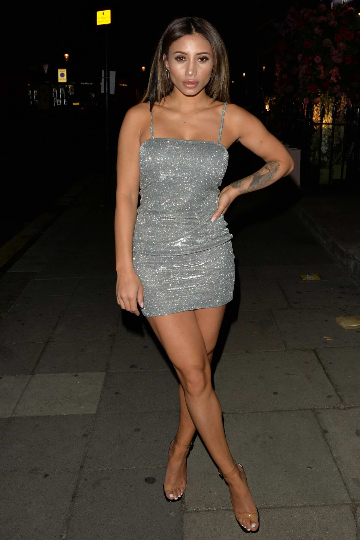 Kayleigh Morris wears a grey mini dress during a night out at Sumosan Twiga in Knightsbridge, London, UK