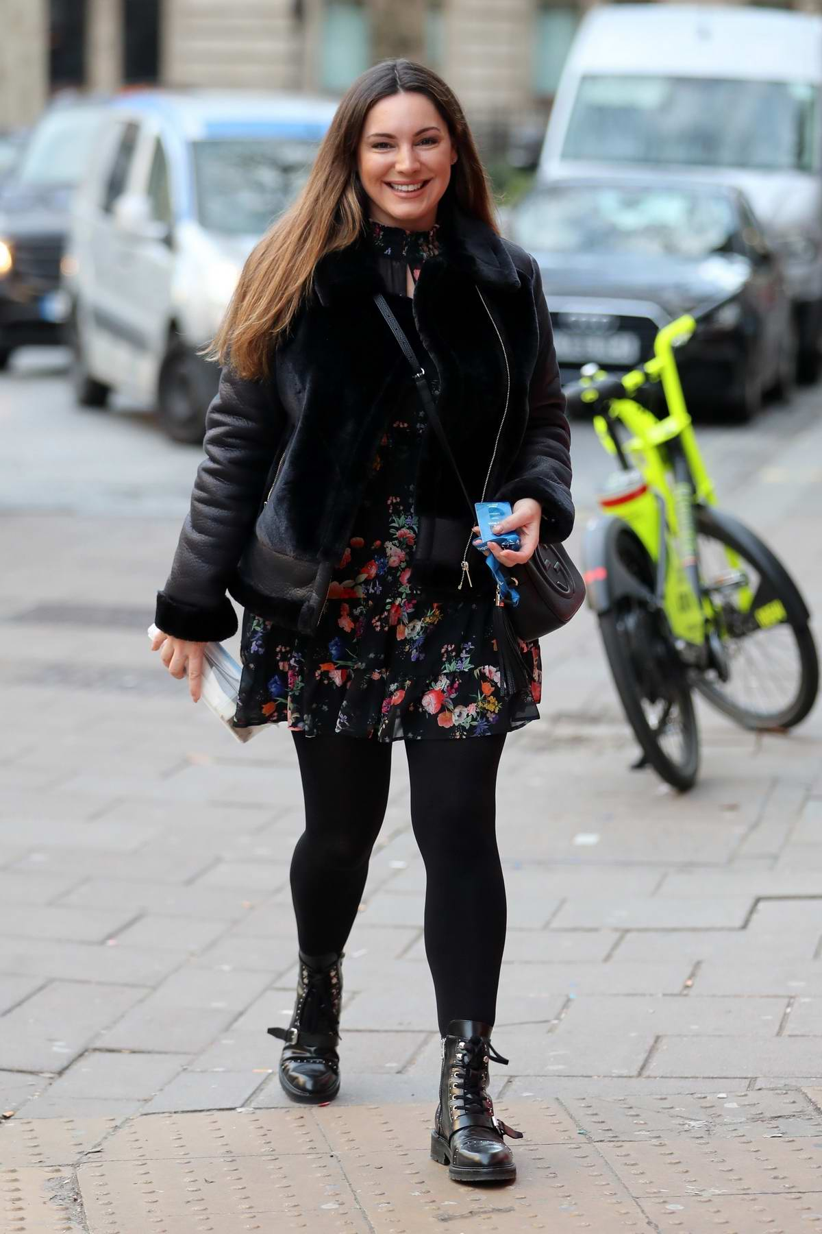 Kelly Brook looks great in a floral print mini dress as she arrives at Heart Radio in London, UK