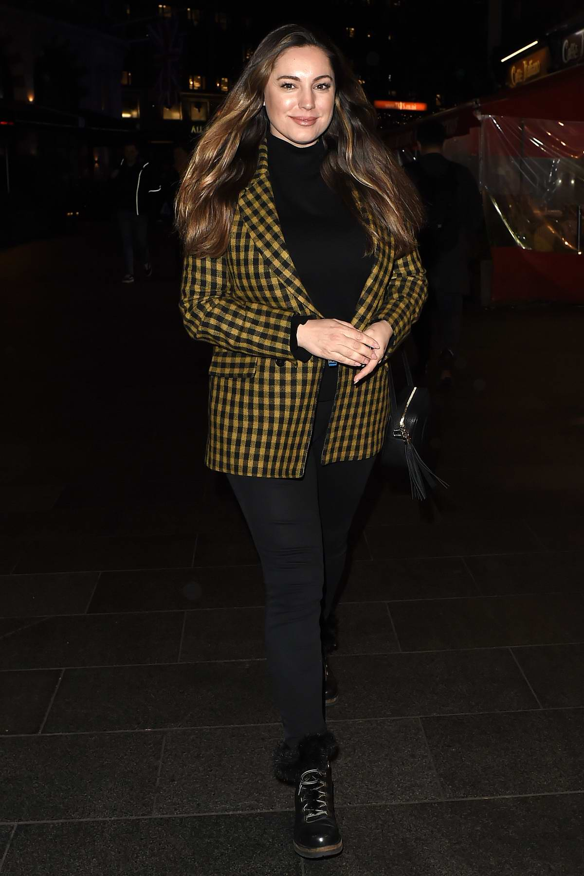 Kelly Brook looks lovely in a checkered coat as she leaves Global Radio Studios in London, UK