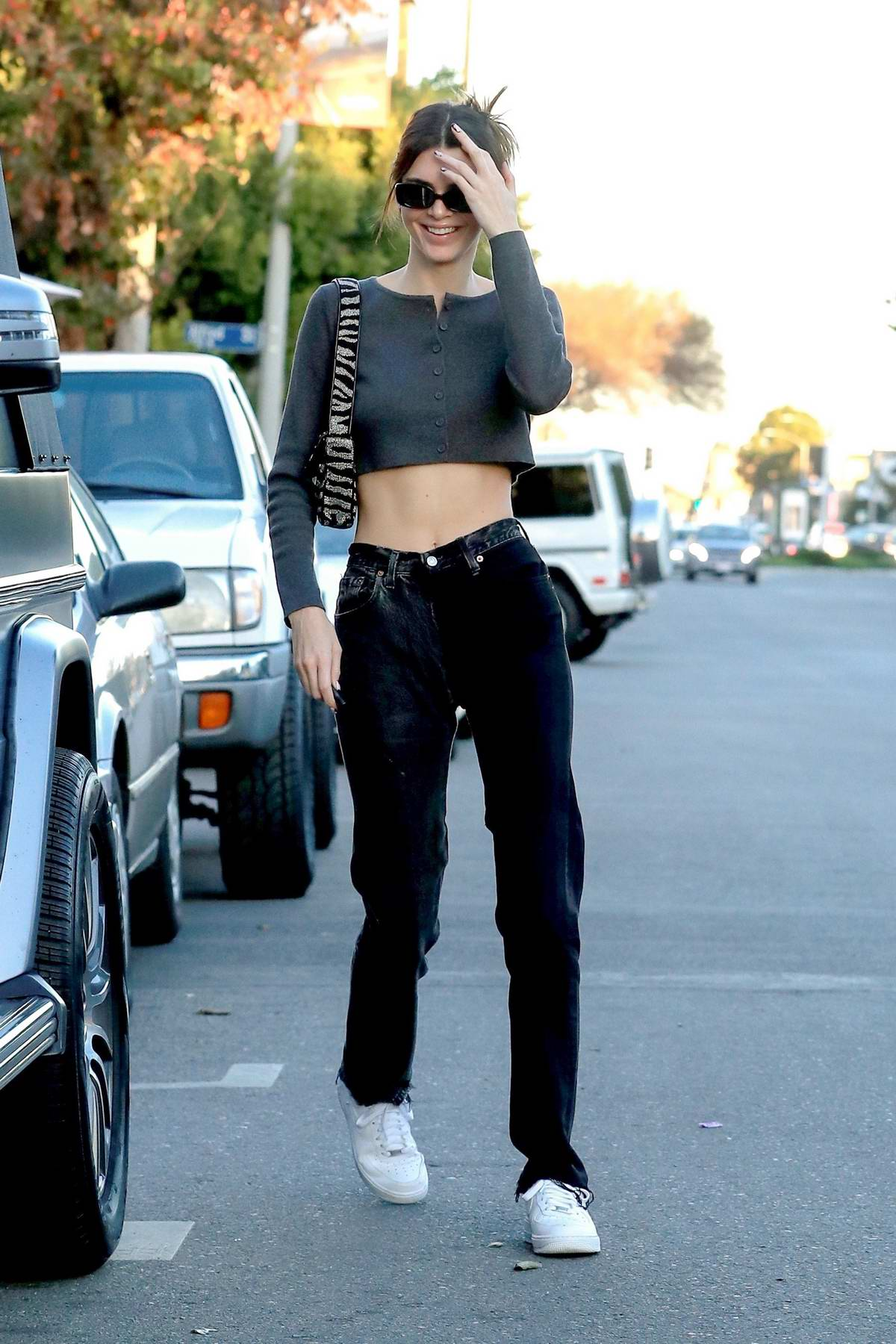 Kendall Jenner flaunts her slender figure in a crop top while out with friends at Alfreds in West Hollywood, California