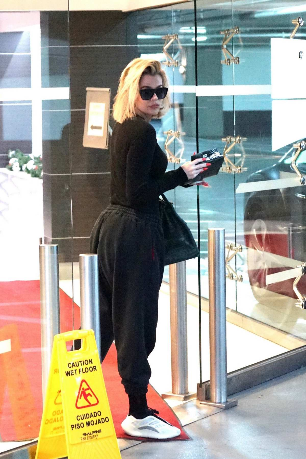 Khloe Kardashian dresses in all-black as she visits a doctor's office in West Hollywood, California