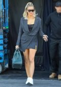 Khloe Kardashian shows off her legs in a pinstripe wrap dress as she leaves a studio in Calabasas, California