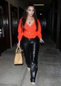 Kim Kardashian rocks bright orange jacket and black leather pants as she visits SEV Laser in Calabasas, California