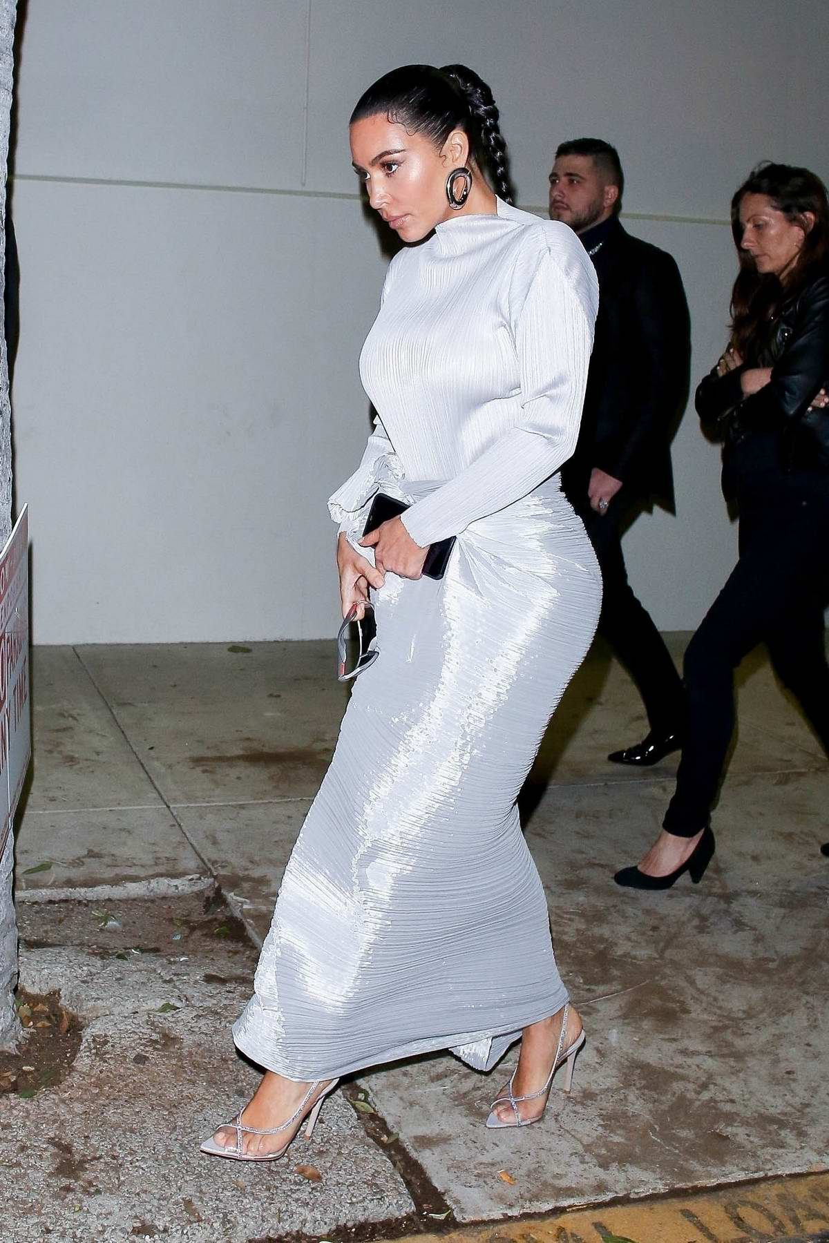 Kim Kardashian stuns in white as she leaves the Midnight Sunday service in Los Angeles