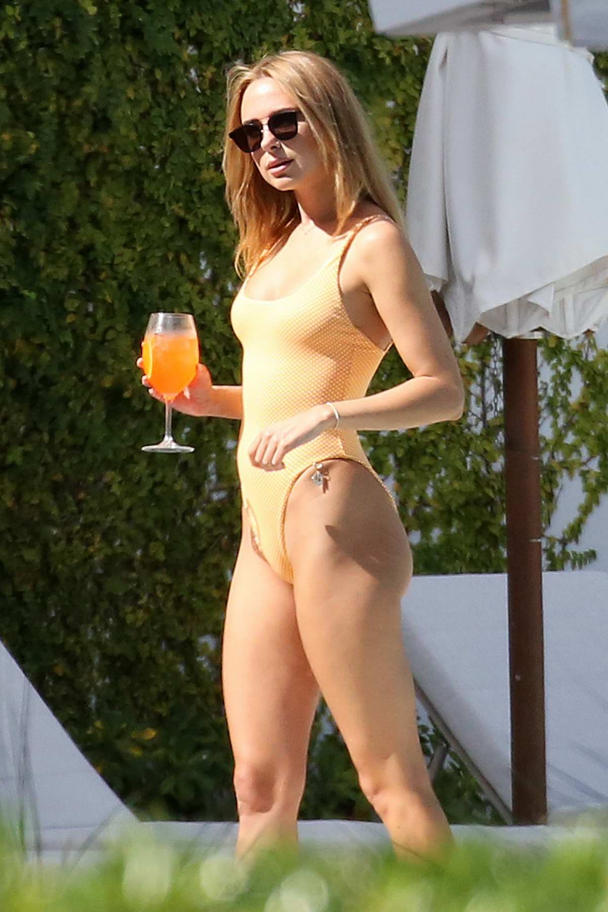 Kimberley Garner looks sensational in an orange swimsuit while on holiday in Miami, Florida