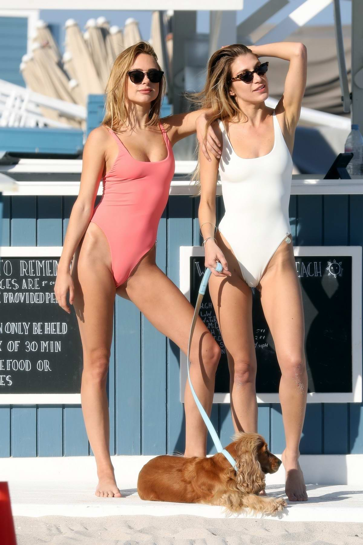 Kimberley Garner poses in a peach pink swimsuit during a beach photoshoot in Miami Beach, Florida