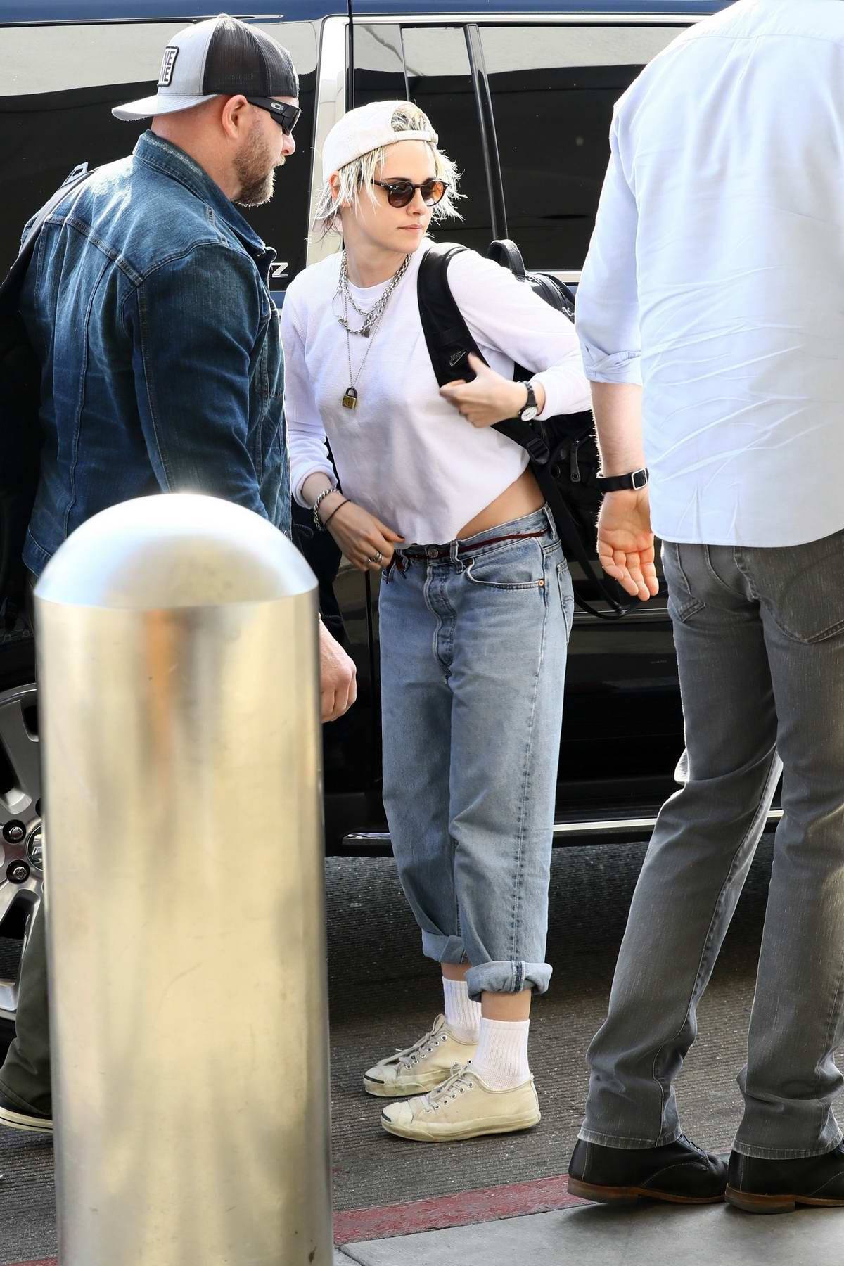 Kristen Stewart keeps it casual as she arrives to catch a flight out of LAX airport in Los Angeles