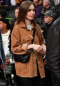 Lily Collins attends Los Angeles Lakers vs Cleveland Cavaliers game at the Staples Center in Los Angeles