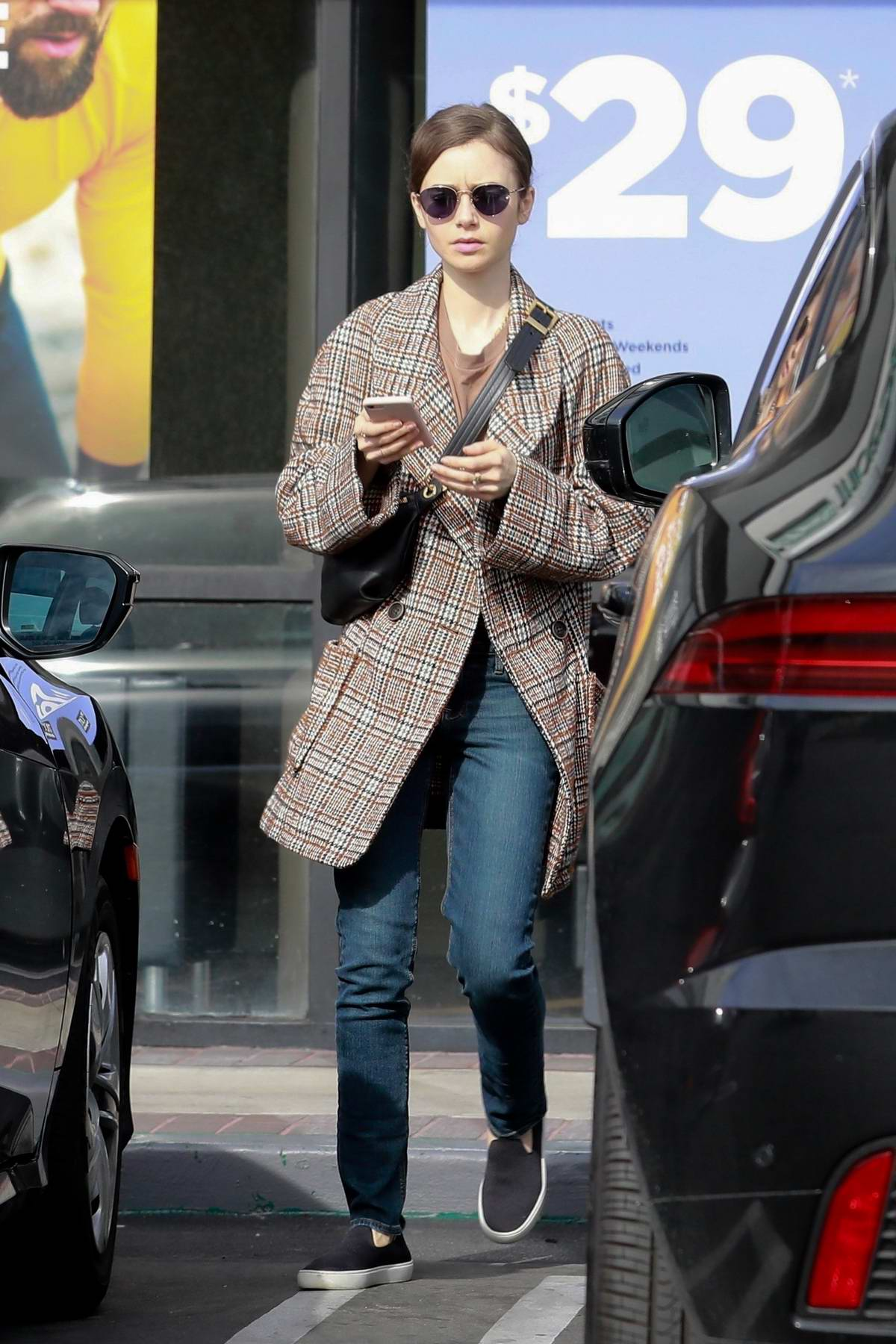 Lily Collins spotted in a tweed coat as she leaves after a massage therapy in Hollywood, California