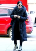 Lucy Hale bundles up in a hoodie and puffer jacket as she step out on a chilly day in New York City