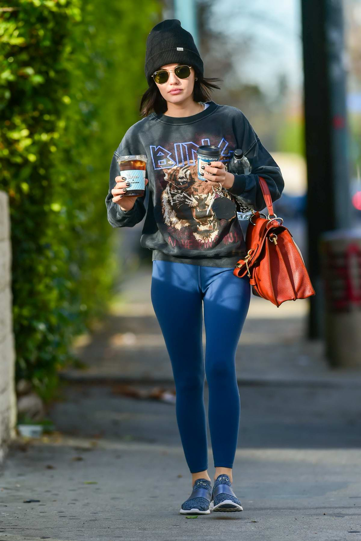 Lucy Hale sports sweatshirt and leggings as she makes a morning coffee run in Los Angeles