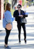 Lucy Hale wears a black jacket and leggings as she leaves the gym and grabs coffee with a friend in Studio City, California