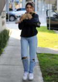Madison Beer cuddles her pup outside of Cha Cha Matcha in West Hollywood, California