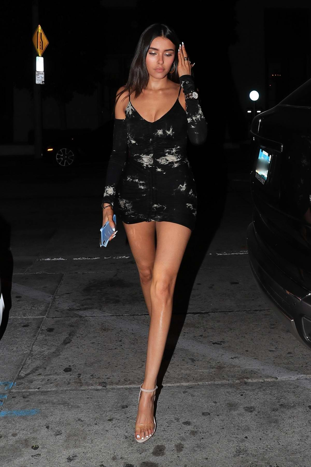 Madison Beer shows off her slender legs in black mini dress during a night out at Catch LA in West Hollywood, California