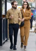 Mandy Moore wears a brown jumpsuit as she steps out with husband Taylor Goldsmith in Los Feliz, California