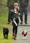 Meghan Markle is all smiles while enjoying a casual stroll with her baby at a neighborhood park in Victoria, Canada