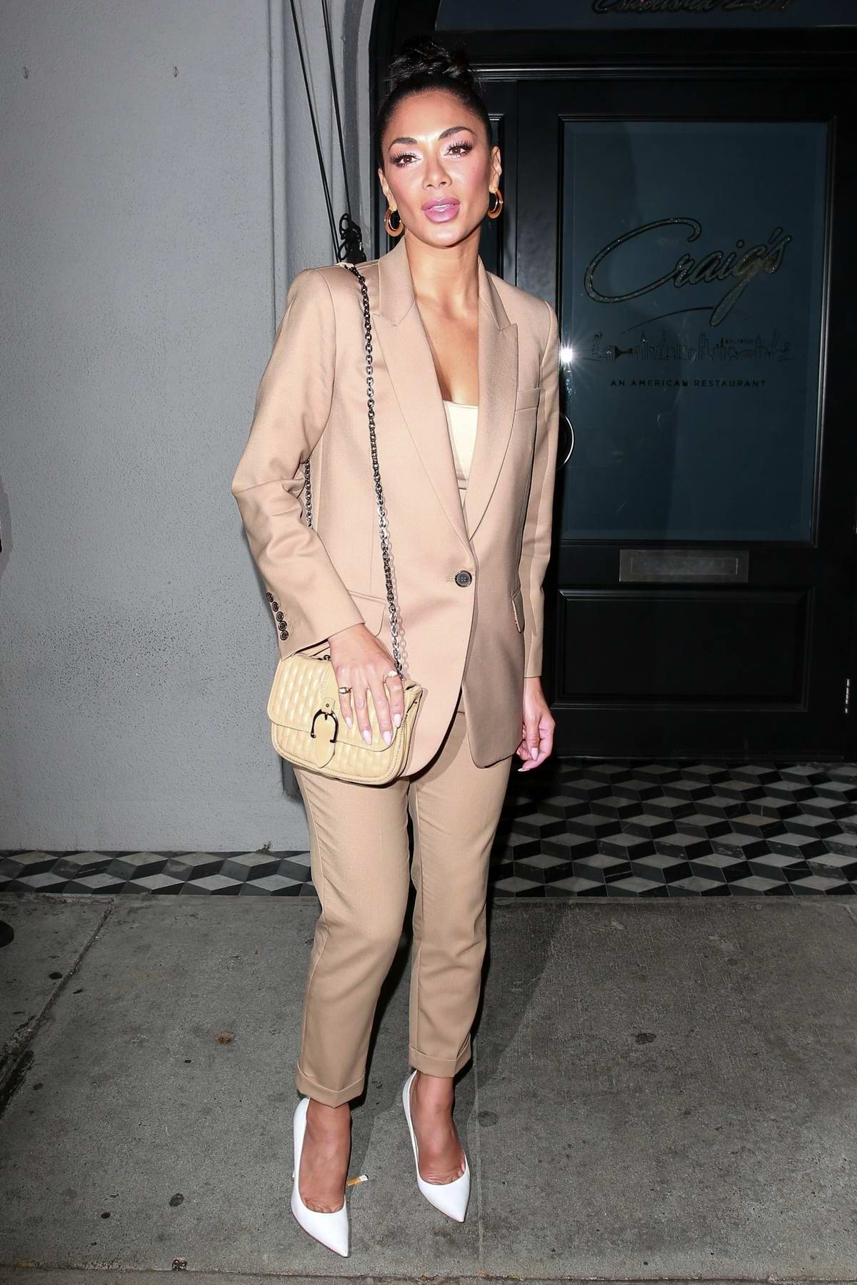 Nicole Scherzinger seen wearing a beige suit as she leaves Craig's in West Hollywood, California