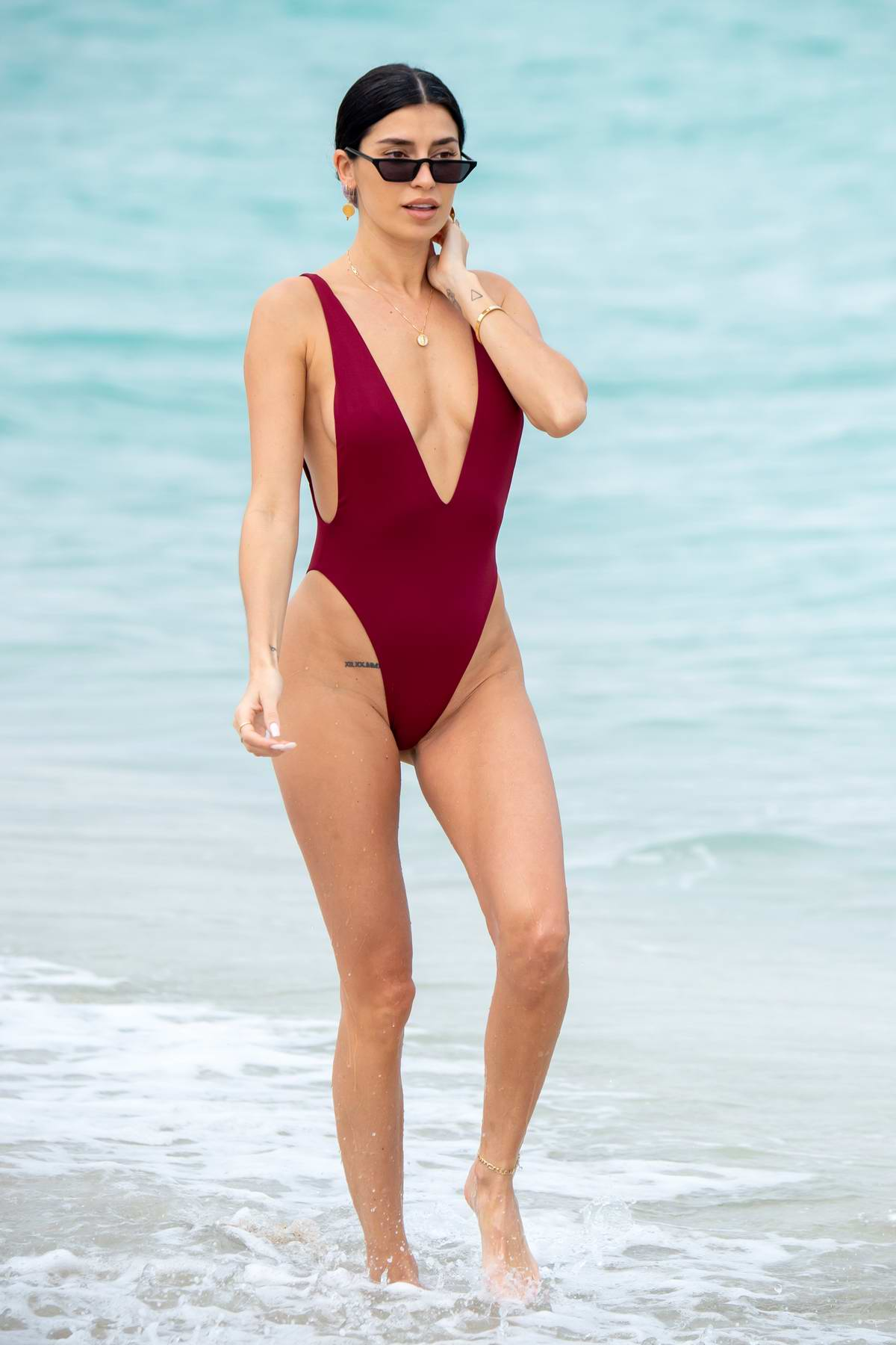 Nicole Williams looks amazing in a maroon swimsuit ahead of her Ocean Drive Magazine cover party in Miami, Florida