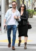 Nikki Bella shows off her baby bump while she and Artem Chigvintsev head to lunch at Spago's in Beverly Hills, California