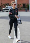 Nina Dobrev rocks biker jacket and black leggings during a shopping trip to XIV Karats in Beverly Hills, California
