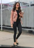 Nina Dobrev rocks coral pink leather jacket with black top and leggings as she runs errands in West Hollywood, California
