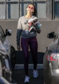 Nina Dobrev sports a grey sweatshirt and purple leggings as she leaves the gym in West Hollywood, California