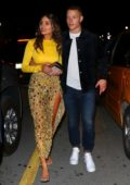 Olivia Culpo looks stunning in yellow during a date night with boyfriend Christian McCaffrey in Miami, Florida