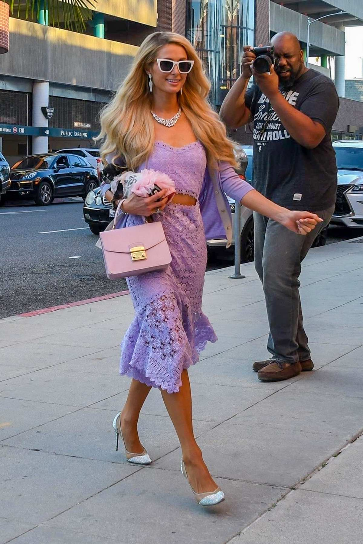 Paris Hilton arrives in style in her holographic pink BMW at Anastasia salon in Beverly Hills, California