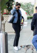 Priyanka Chopra wears a custom denim jacket as she arrives at The Peninsula Beverly Hills in Beverly Hills, California