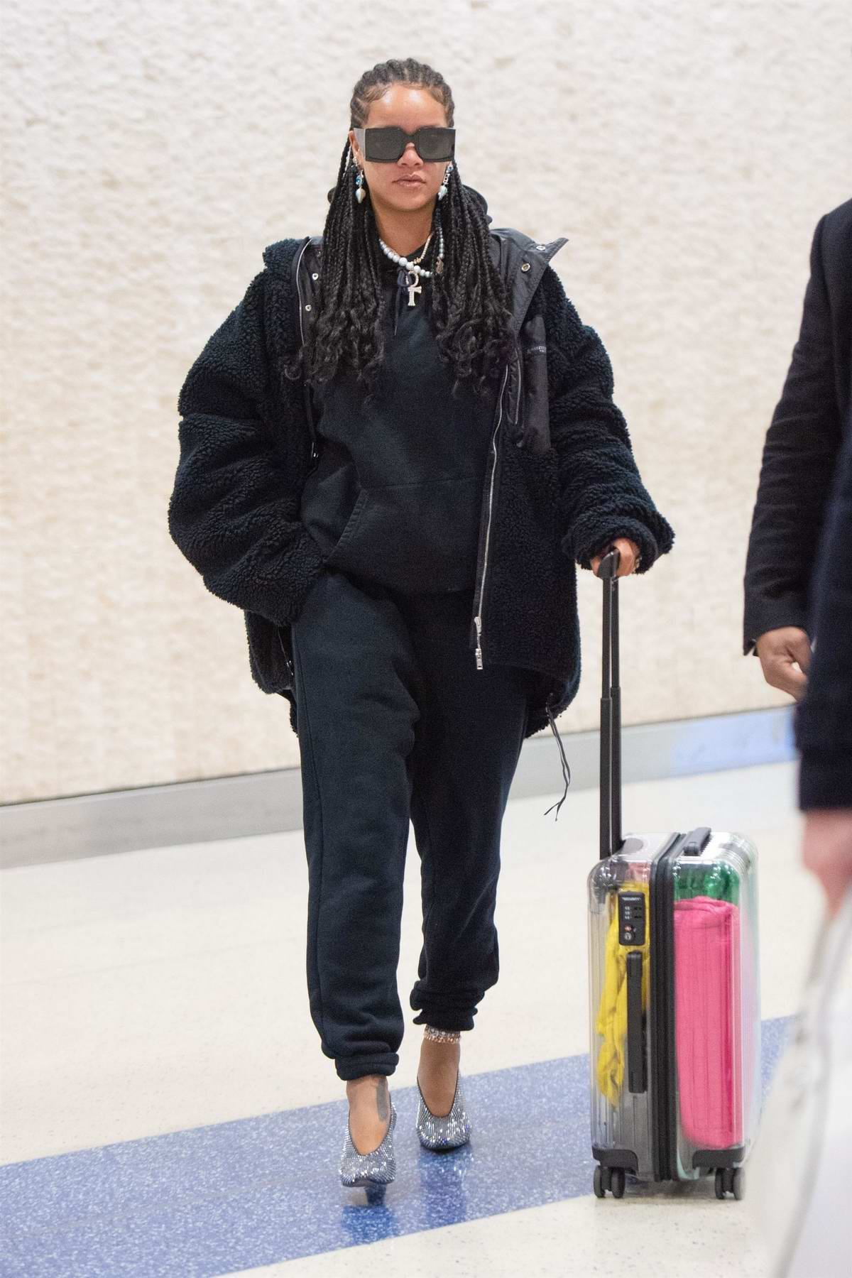Rihanna looks trendy as she arrives at JFK Airport in New York City